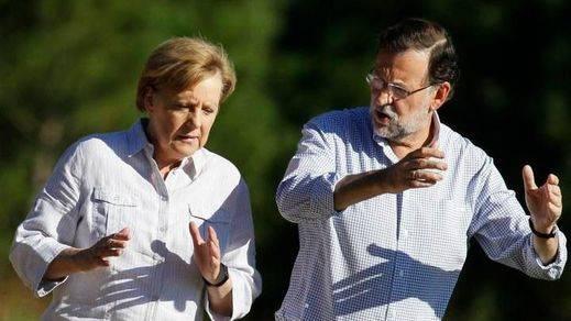 Cameron y Merkel, en España de vacaciones de Semana Santa