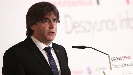 Puigdemont, en Madrid, invita al Gobierno a pactar fecha y pregunta del referéndum
