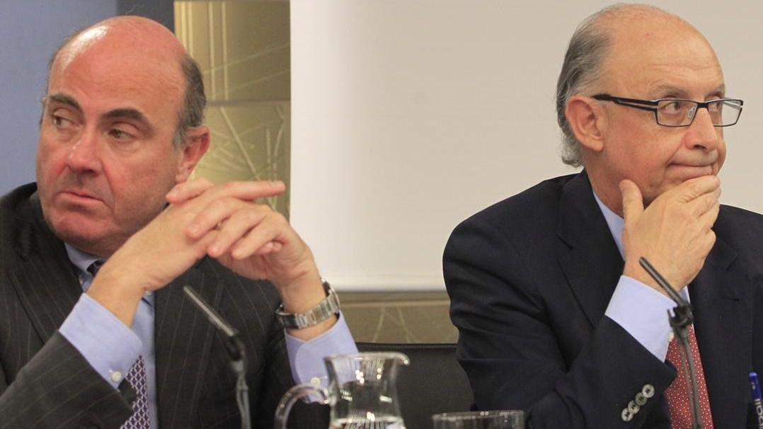 Guindos y Montoro, reforzados en el nuevo Gobierno Rajoy... entre comillas