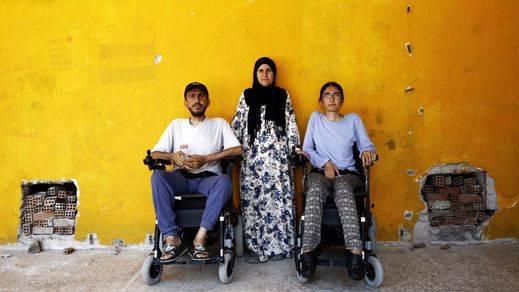 El increíble viaje de dos hermanos discapacitados que huyeron del infierno sirio