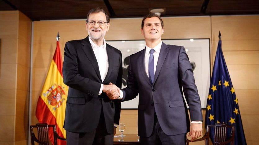 Mariano Rajoy y Albert Rivera, durante su negociación sobre el pacto de investidura