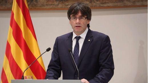 Puigdemont exige la retirada de policías y guardias civiles por su
