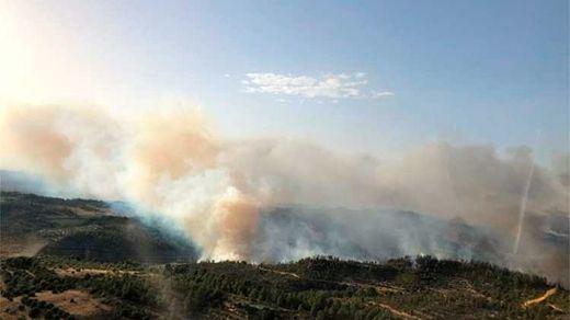 Los medios de extinción siguen actuando en los incendios de Gavilanes (Ávila) y Cenicientos (Madrid)