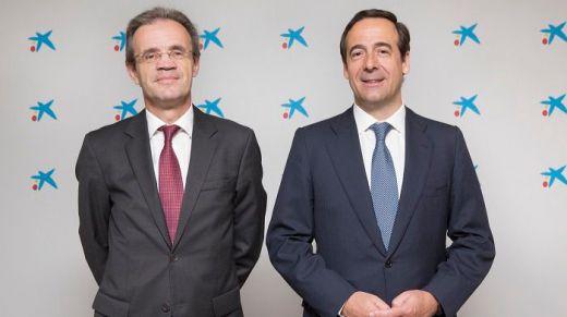 Jordi Gual, presidente de CaixaBank, y Gonzalo Gortázar, consejero delegado de CaixaBank