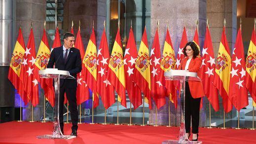 Moncloa y Madrid, de la 'unión de las banderas' al choque de trenes