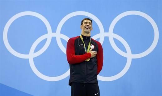 Phelps agranda su leyenda con su medalla número 25