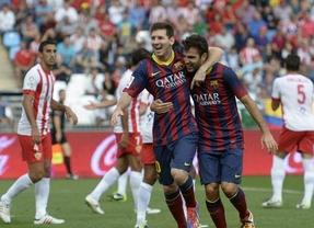 Un Barça de récord y con su estilo clásico gana fácil al Almería, pero pierde a Messi lesionado (0-2)
