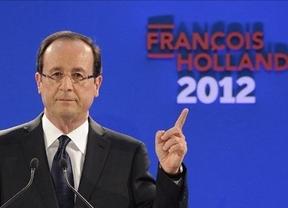 Hollande 'mete' a Merkel en la campaña Francesa