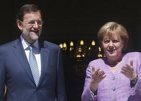 Repasos al año de Rajoy: la patronal le pide menos recortes en 2013; Merkel no quiere rescates