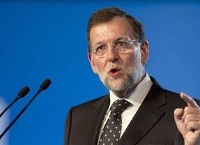 ¿Coincidencia horaria? Rajoy defiende la reforma laboral en Sevilla mientras España se manifiesta