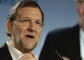 La campaña andaluza empieza fuerte: Rajoy ilustra una noticia sobre pederastia