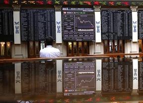 Los mercados arrancan la semana de capa caída: el Ibex cae y la prima se mantiene 'apática'