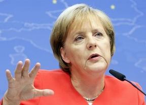 La 'alianza' Merkel-Rajoy parece funcionar: la canciller pide confianza en España
