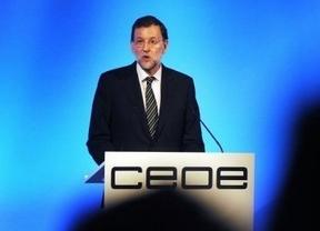 La CEOE celebra Asamblea con Rajoy en su peor día tras cuestionar los permisos por defunción de familiares
