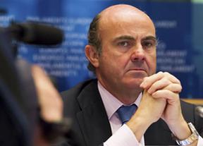 Guindos dice que España debe reducir su déficit a un ritmo