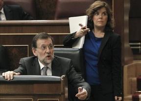 Rajoy y el Gobierno en bloque defienden a ultranza su 'amnistía fiscal' evitando nombrar a Rato en todo momento
