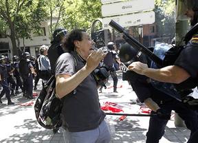 Investigarán la agresión policial a un fotógrafo de 'Madridiario.es'