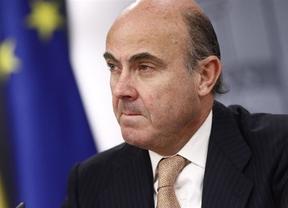 La Comisión investiga las ayudas a la banca en España y Guindos defiende su legalidad