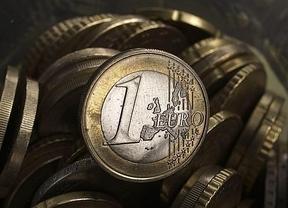 Un año del rescate financiero: La banca presta menos dinero a mayores intereses