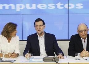 Rajoy da más pistas sobre su reforma fiscal 'equitativa': tachada de electoralista e insuficiente, no favorece a las rentas medias