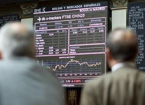 El mercado reacciona ante la decisión del BCE: el euro baja, el Ibex coge impulso y la prima no se inmuta
