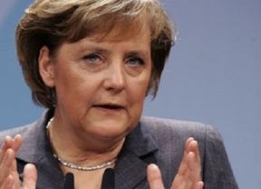 Merkel advierte de que si los fondos europeos compran bonos españoles habrá condiciones