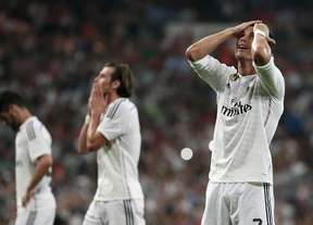 El Madrid se suicida ante un Valencia respondón y afortunado y regala la Liga al Barça (2-2)