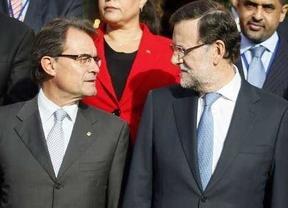 Rajoy presiona a CiU para que apoye la ley de abdicación como el