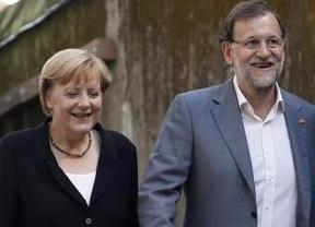 Merkel elogia las reformas de Rajoy y como premio apoyará la candidatura de Luis de Guindos a la presidencia del Eurogrupo