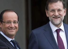 Rajoy y Hollande presionan a Alemania para poner en marcha la unión bancaria y fiscal