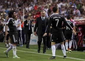 'Supercristiano' emerge en un partido clave y con su triplete lleva al Madrid a salvar el difícil escollo del Sevilla (2-3)