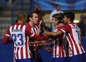 Un Atlético con mucha cabeza: los rojiblancos deciden con dos testarazos de Godín y Raúl García ante un Valencia sin pólvora (2-0)