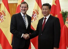 Rajoy y el presidente chino firman la 'paz' después de la mutilación de la Justicia Universal