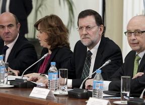 Rajoy saca adelante la reforma financiera con la abstención de PSOE y CiU
