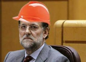 Un casco minero para Rajoy y el lapsus del presidente