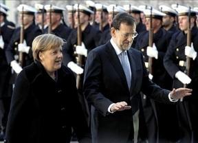 Merkel impide que tan siquiera Rajoy planteara en público la 'amnistía' del déficit a España