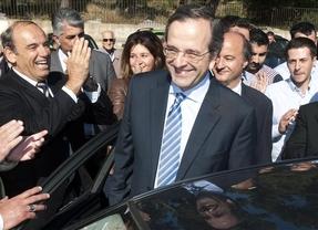 Según los sondeos a pie de urna, el conservador Samarás ganaría las elecciones griegas