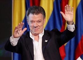 Los colombianos refrendan el proceso de paz y la negociación con las FARC: Santos, reelegido presidente