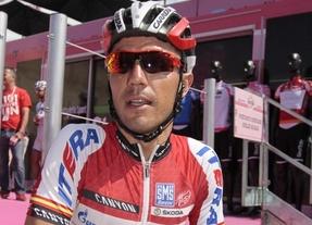 'Purito' Rodríguez gana la etapa y se viste la 'maglia' rosa en el muro de Assisi