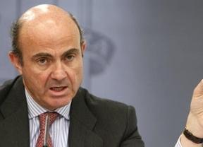 De Guindos sigue 'liando' las cifras: eleva a 52.000 millones las provisiones de la banca