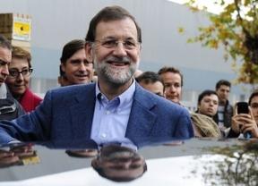 Ataque liberal y una oleada de recortes rodean a Rajoy al comienzo de su era