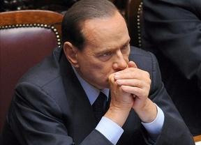 Berlusconi salva los presupuestos 'por los pelos' y pierde la mayoría en el Parlamento