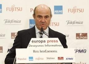 De Guindos anuncia que España adelantará en julio el tercer pago del rescate bancario