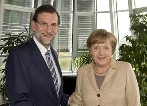Las rebajas de Mariano: Rajoy intenta que Merkel le 'perdone' con el déficit