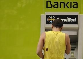 El informe de Oliver Wyman pone en peligro las fusiones bancarias